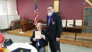 WB Dave presenting MWB Don with a beautiful hand crafted Standard works book